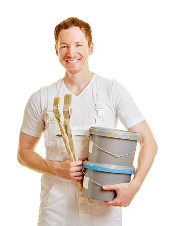 Smiling painter with paint buckets Stock Photo