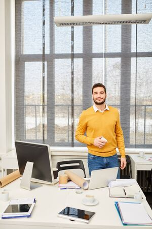 Self confident start-up founder with competence in his place of work Stock Photo