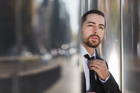 Business man looks full of doubt and thoughtful into the future