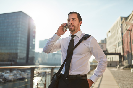 Business man on the phone as mobility concept