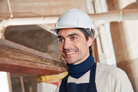 Man as builder carrying wood and working
