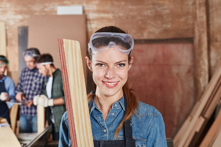 Woman as apprentice of carpentry during apprenticeship