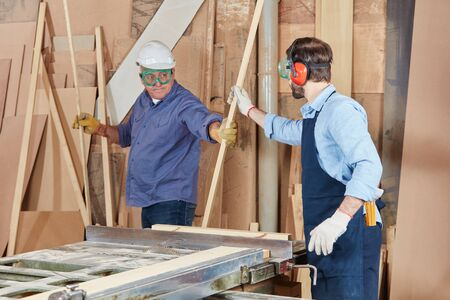 Carpenters woking in teamwork and cooperation