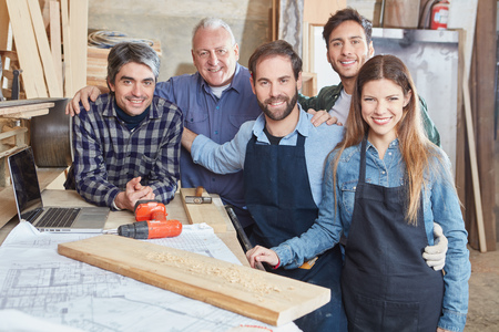 Artisans as a team with men and woman at workshop