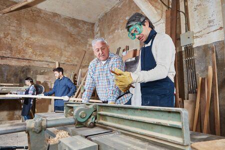 Carpenters during apprenticeship lesson at workshop