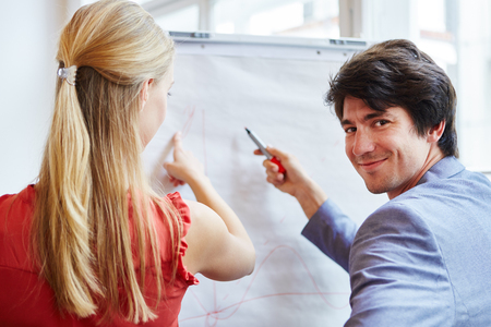 Business people at business team meeting analizing chart Stock Photo