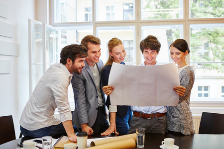 Architects happy about their business plan in a team Stock Photo