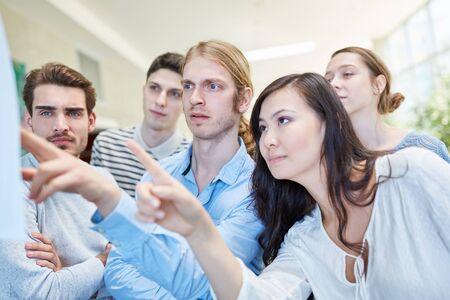 Students check university test evaluation grades performance