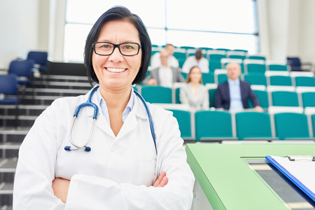 Woman as medicne lecturer and doctor standing with pride