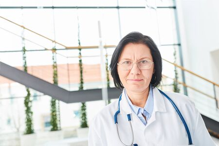Portrait of senior woman as physician or medical specialist with experience