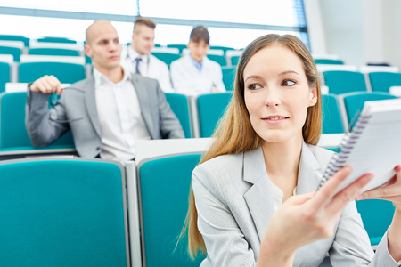 Young woman as medicine student in university lecture hall Stock Photo