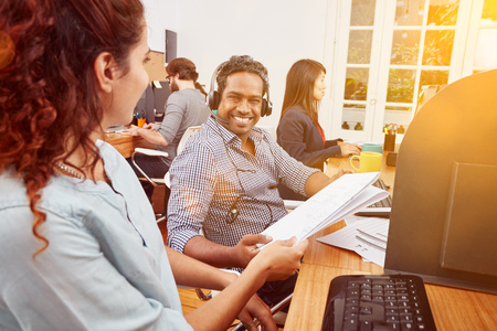 Indian call center operator with headset at work Stock fotó - 96237671
