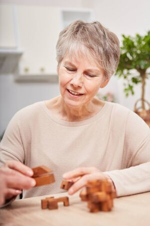 senior woman with dementia building blocks for memory training Stock Photo