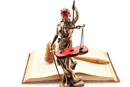 Justitia with law book and paragraph as justice concept Stock Photo