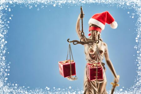 Christmas with Justitia as Santa Claus and presents