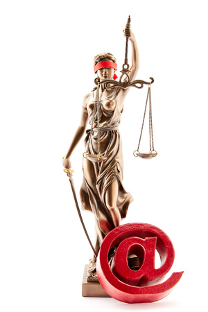 Blind Justitia with at symbol and Libra as online law concept