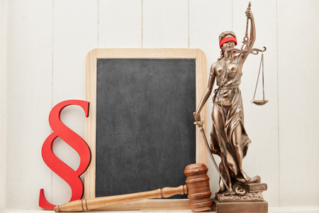 Employment law advice concept with Justitia and blackboard and judge gavel Stock Photo