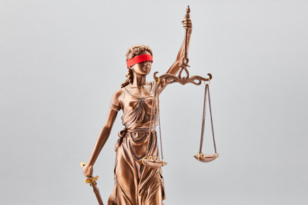 Law and Justice Concept with Justitia with Libra and sword and blindfold