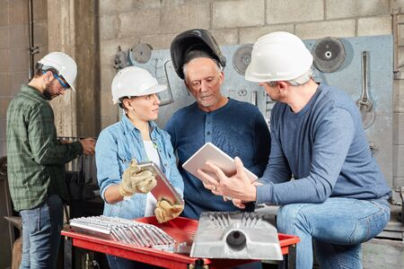 Team of workers planning in meeting with tablet computer
