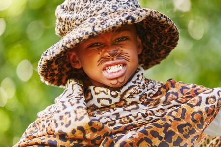African child with creative leopard costume and face paint Stock Photo