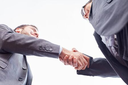 Businessmen shake hands as a sign of partnership or greeting