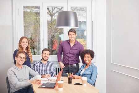 Group of young students as a multicultural business team in the conference room Stock Photo