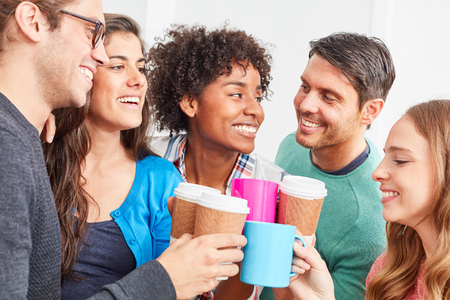 Students in the Business Start-Up have a coffee break together Stock Photo