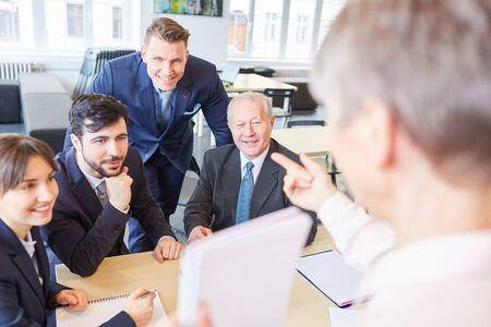 Business team in business training listen to seminar speaker