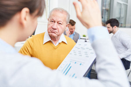 Senior consulting businessman stares with scepticism Stock Photo