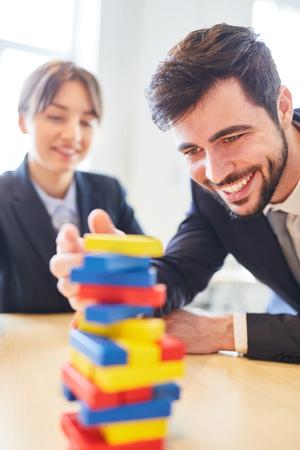 Man bulding blocks as creativity exercise in team building seminar