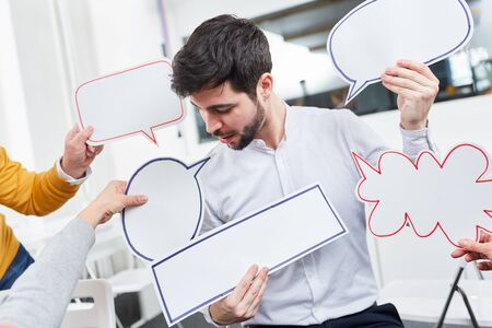 Man in creative communication workshop with speech bubbles for brainstorming ideas