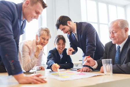 Business people play team bulding game at creative seminar  Stock Photo
