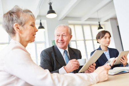 Senior business team in meeting discussion for strategy planning Stock Photo