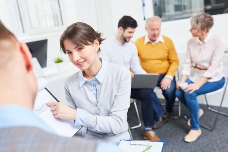 Woman as finance trainee makes business analysis in workshop Stock Photo