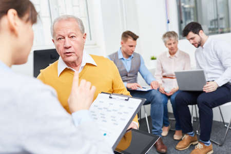 Business consulting advice concept with senior team member Stock Photo