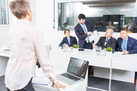 Businessman in seminar in discussion with speaker during a lecture Stock Photo