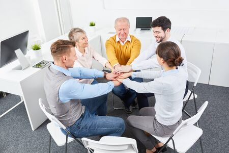 Business people stack hands togehter as training motivation exercise