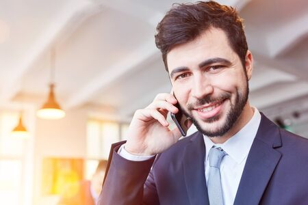 Man as startup business consulting founder calling with smartphone