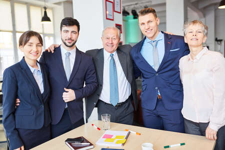Successful business team with manager standing proud as a group Stock Photo