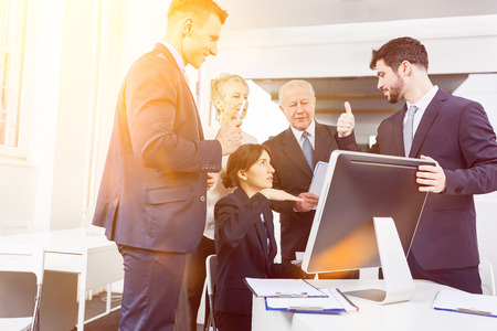 Business team with computer videoconferencing as a group Stock Photo