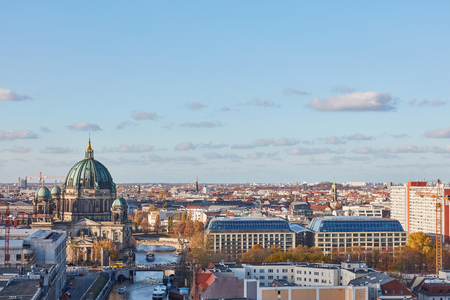 Skyline with Berlin Cathedral in Berlin next to Spree at daytime with a blue sky