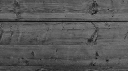 Black wood surface as a dark background texture Stock Photo
