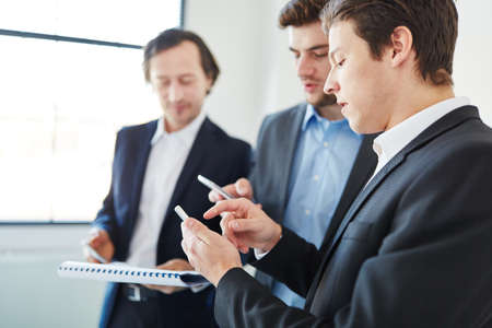 Business people planning as team with smartphone and calendar