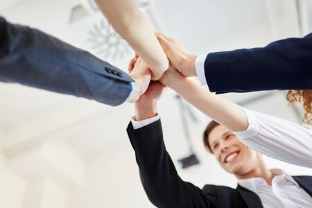 Successful team holding hands together in start-up Stock Photo