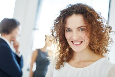 Successful businesswoman content with her start-up and smiling Stock Photo