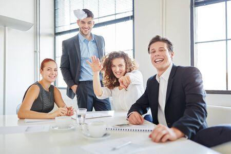Creative business team having fun throwing paper balls Stock Photo