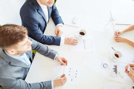 Start-up team in statistics analysis meeting Stock Photo