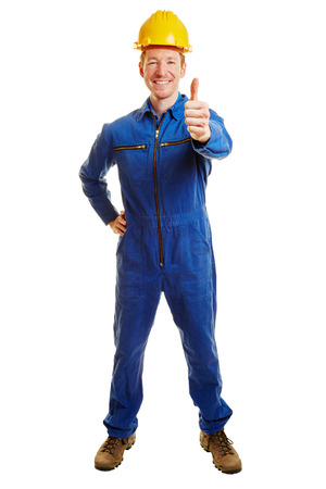 Construction worker with a builder suit and a helmet holding thumbs up