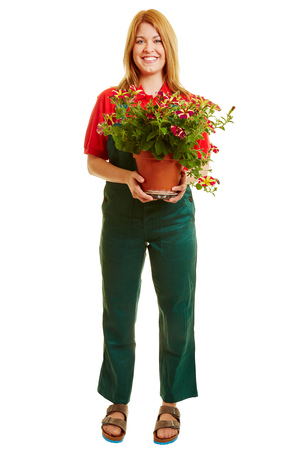 Woman as a gardener with plants on her hand