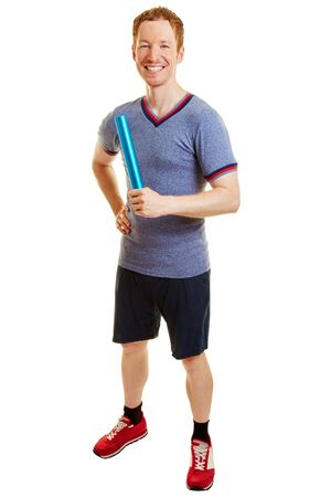 Man as a runner with a baton smiling  Stock Photo